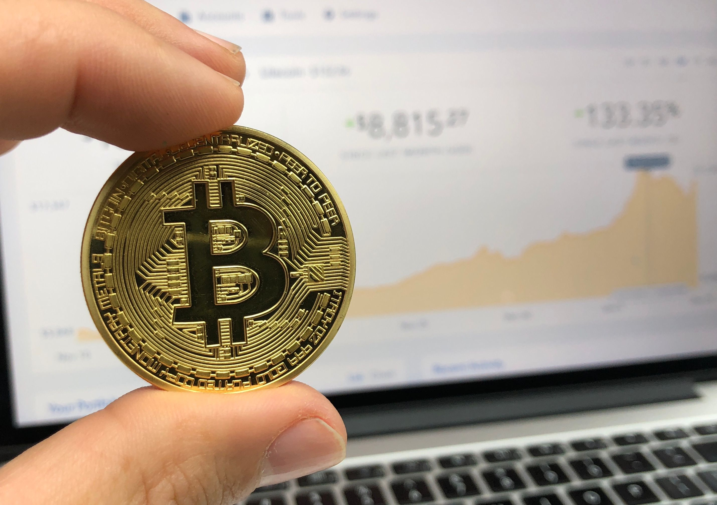 Bitcoin with PC in background